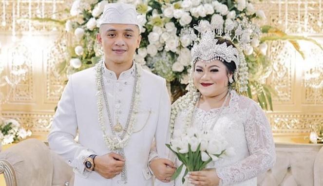 Olivia Nathania dan Rafly N. Tilaar saat menikah. [Sumber Gambar]